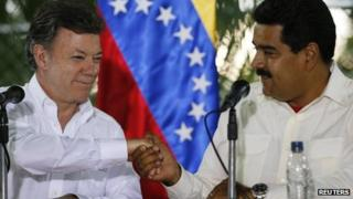 Juan Manuel Santos (left) and Nicolas Maduro (right)