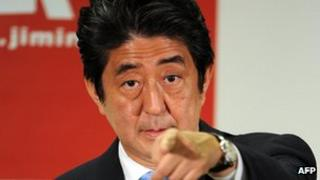Japanese Prime Minister and ruling Liberal Democratic Party (LDP) leader Shinzo Abe during a press conference at the LDP headquarters in Tokyo on 22 July 2013