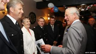 Prince Charles laughing with people