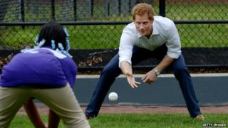 Prince Harry plays catch with a youngster