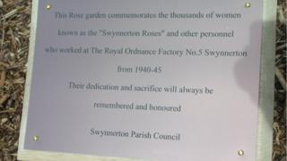 Plaque next to rose bed