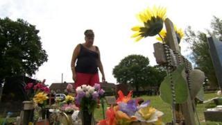 Maria Radford at her daughter's grave