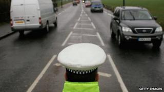 Police officer monitoring traffic