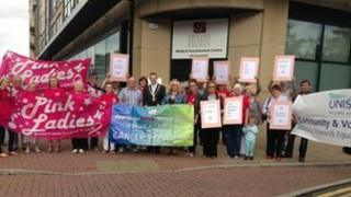 Cancer support group protest outside the Londonderry building where government medical tests to check whether cancer patients are able to work are carried out