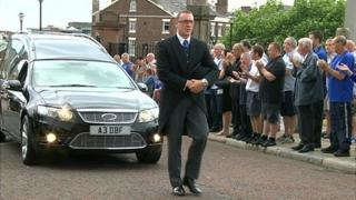 Supporters applauding Dave Hickson's funeral cortege
