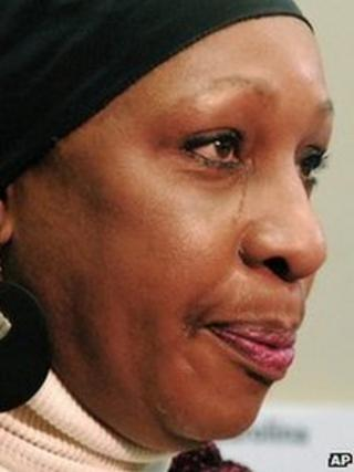 Elaine Riddick sheds a tear as she talks to the media following the task force meeting 10 January 2012