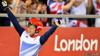 Britain's Jason Kenny celebrates after crossing the finish line to win the gold medal in the London 2012 Olympic Games men's sprint final cycling event