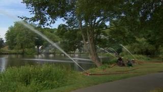 Pumping at Pitville Park lake Cheltenham