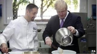 Mayor of London Boris Johnson makes a Gu chocolate souffle with head chef