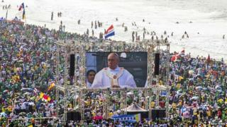Pope Francis on video screen