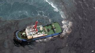 In this photo taken 27 July 2013, a cleaning vessel clears the oil after about 50 tons of crude oil was leak from a pipe spilled into the sea off Rayong province, eastern Thailand