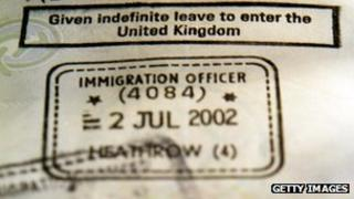 "A foreign passport is stamped with the coveted ""Given Indefinite leave to enter the United Kingdom"" permit"