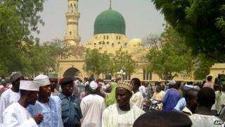 A crowd wait outside the central mosque in the northern Nigeria city of Kano in May 2012