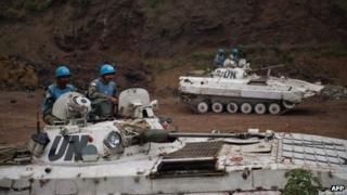 Indian peacekeepers as part of the UN mission in the DR Congo behind Congolese army lines in an abandoned quarry in Munigi, 8km from Goma on 19 July 2013.