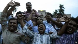 Osmania University students celebrate after the announcement of the separate Indian state of Telangana in Hyderabad on July 30, 2013
