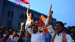 Osmania University students celebrate after the announcement of the separate state of Telangana in Hyderabad on July 30, 2013