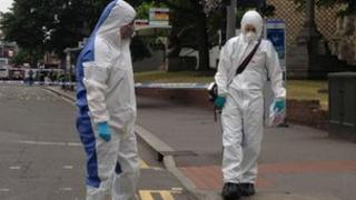 Forensic officers at scene of suspected stabbing