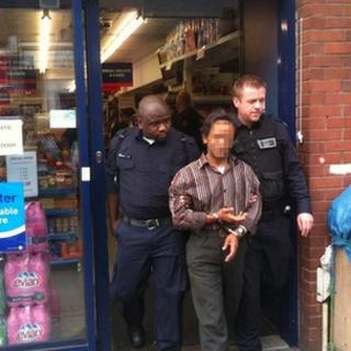 UK Border Agency officers arrest a suspected illegal worker