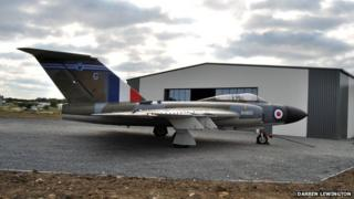 Aircraft outside new Jet Age Museum hangar