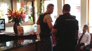 Officers raiding restaurant