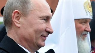 Russian President Vladimir Putin (L) and Russia's Patriarch Kirill