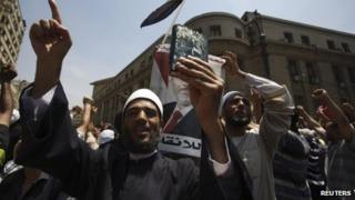 Clerics supporting deposed Egyptian President Mohamed Morsi and members of the Muslim Brotherhood shout slogans as they close the roads in front of the courthouse and the Attorney General's office