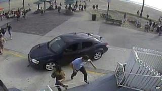 CCTV shows a car drives through a packed afternoon crowd along the Venice Beach boardwalk in Los Angeles on Saturday 3 August 2013