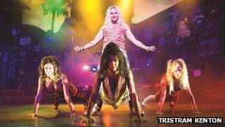 Members of the cast of Rock of Ages. Photo by Tristram Kenton
