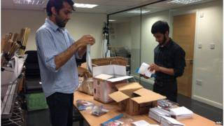 charity volunteers making up Eid packs