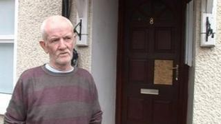 Terence Halpin outside his front door where the shots were fired