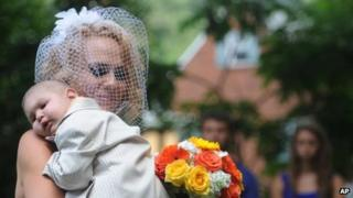 Logan is carried down the aisle by Christine Swidorsky