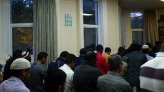 Prayer takes place between the first and second courses