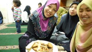 The women eat and pray separately from the men - these three are from Malaysia