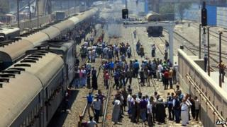 Egyptian Muslim Brotherhood supporters of deposed president Mohamed Morsi block the railway line at Giza Station which runs to upper Egypt on 7 August, 2013, in Cairo.