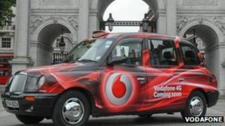 taxi with vodafone logo