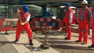 Boris Johnson laying the final paving stones