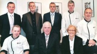 The six McErlain brothers, pictured with their parents, who founded the family firm in 1968
