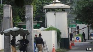 Pakistani security personnel stand guard outside the US consulate in Lahore on 5 August 2013