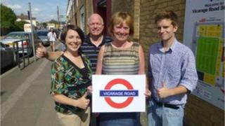 Mayor Dorothy Thornhill holding Vicarage Road sign