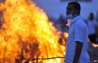 A member of the Muslim Brotherhood and supporter of ousted Egyptian President Mohammed Morsi during clashes near a television production complex in Six October City in Giza, south of Cairo 2 August, 2013.