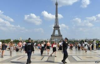 French police patrol on 7 July, 2013 on the Trocadero plaza in front of the Eiffel Tower in Paris.