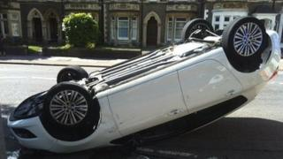 The car on its roof in Cardiff
