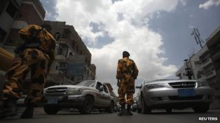 Yemeni police guard a checkpoint on a street in Sanaa on 10 August 2013