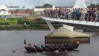 boat below peace bridge