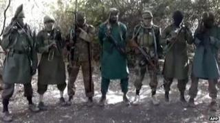 Militant leader believed to be Abubakar Shekau (C), with armed and masked Boko Haram militia (file photo)