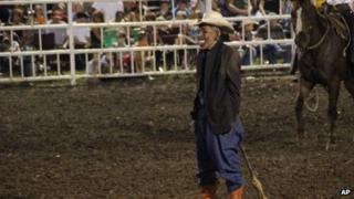 An unidentified rodeo clown dons an Obama mask at the Missouri State Fair (10 August 2013)