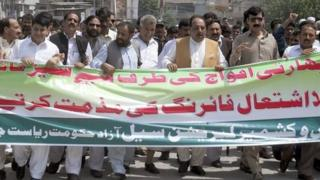 Prime Minister of Pakistan-administered Kashmir Chaudhry Abdul Majeed (3rd R), with his supporters, takes part in an anti-Indian protest rally in Muzaffarabad, the capital of Pakistan-administered Kashmir, August 12, 2013.