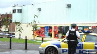 The attack happened at Woodbourne police station in west Belfast