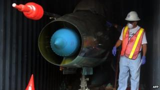 A man works in a container with the MiG-21 jets found inside the North Korean Chong Chon Gang vessel where an alleged Soviet-built radar control system for surface-to-air missiles was found, at the Manzanillo Port in Colon, Panama on 21 July, 2013