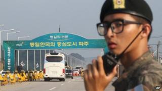 A bus carrying South Korea's delegation leaves for Kaesong on 14 August 2013